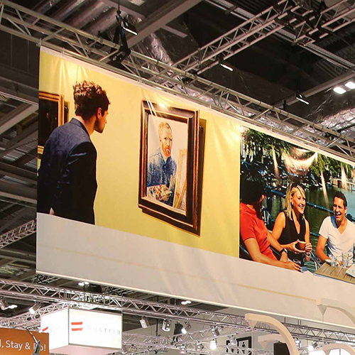 Stand out and be seen at exhibitions with large format hanging banners.