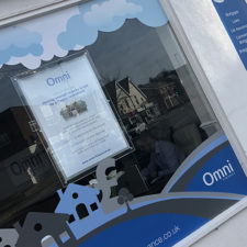 Shop window vinyls with an A1 LED window card and a duratran poster.