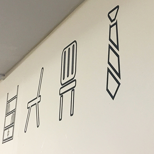 Add some interest to your plain walls with cut vinyl shapes and lettering to suit your branding.