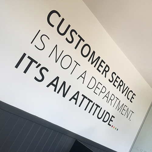 'Customer Service' Cut Vinyl to spruce up the office walls.
