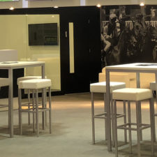 Create an impact with wallpaper that runs length of your exhibition stand.