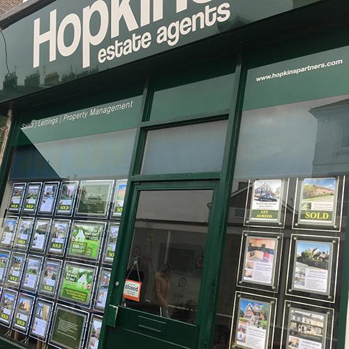 Estate agent fascia and duratran window cards.